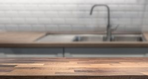 Kitchen island with wooden table top for product display montage. stock photo