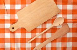 Kitchen kit made from wood on checkered orange white dishtowel. Kitchen kit made from wood on checkered orange white cotton dish towel Royalty Free Stock Image
