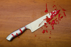 Kitchen knife in blood. On the table Royalty Free Stock Photography