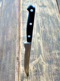 Kitchen knife board. Sharp kitchen knife on the board Royalty Free Stock Photo