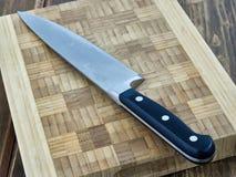 Kitchen knife board. Sharp kitchen knife on the board Stock Photo