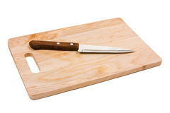 Kitchen knife on a cutting board Royalty Free Stock Photography