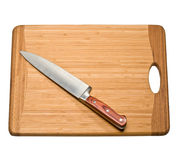 Knife on a cutting board. Kitchen knife on a cutting board on a white background Stock Photos