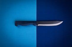 Kitchen knife over blue background Stock Image