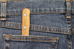 Kitchen knife in the pocket of jeans Royalty Free Stock Images