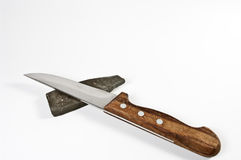 Kitchen knife and sharp stone Royalty Free Stock Photos
