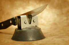 Kitchen knife and sharpener Stock Photography