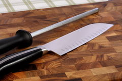 Kitchen knife and sharpening Royalty Free Stock Photo