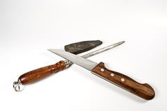 Kitchen knife and stone for sharpening Royalty Free Stock Image