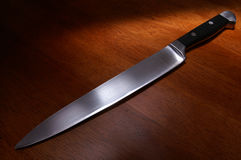 Kitchen knife on table. Close-up of kitchen knife on table royalty free stock photo