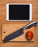 Kitchen. Knife with tablet Royalty Free Stock Photos