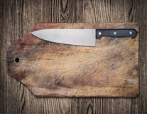 Kitchen knife on wooden table. Kitchen knife on wooden cutting table, copy space, clipping path Royalty Free Stock Images