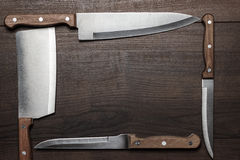 Kitchen knifes on the brown wooden table Stock Photo