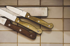 Kitchen knives on magnet Royalty Free Stock Photos
