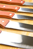Kitchen knives in a row Stock Image
