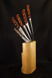 Kitchen knives and their wooden block Royalty Free Stock Photos