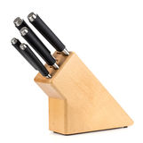 Kitchen knives in a wooden stand on a white background Royalty Free Stock Photos