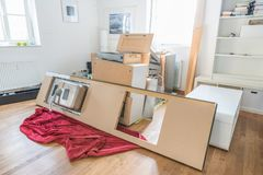Kitchen laid out in the living room, disassembled into individual parts.  stock image
