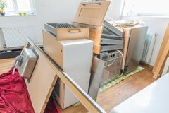 Kitchen laid out in the living room, disassembled into individual parts.  stock photo