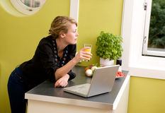 In Kitchen with Laptop Royalty Free Stock Photo