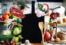 Black Board with vegetables and bread Royalty Free Stock Photos