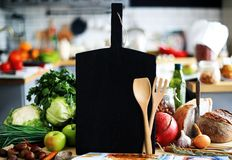 Black Board with vegetables and bread Stock Photography