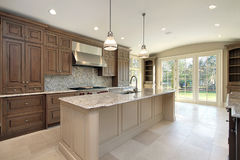Kitchen with large marble island stock photography