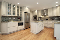 Kitchen with light colored cabinetry Stock Image