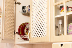 Kitchen of light-coloured wood with various utensils Royalty Free Stock Photography