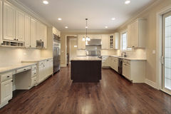 Kitchen with light wood cabinetry royalty free stock images