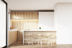 Kitchen with light wooden furniture Royalty Free Stock Photography