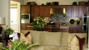 Kitchen & Living Room. A view of the kitchen with the living room in the forground Royalty Free Stock Photo