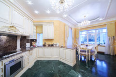 Kitchen with luxury furniture in classic style stock photography