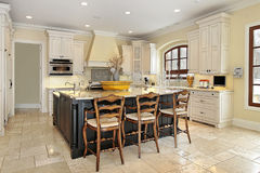 Kitchen in luxury home. With walnut island Stock Photo