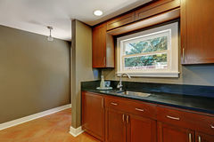 Kitchen mahogany cabinets with a sink. House interior. Northwest, USA Royalty Free Stock Image