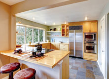 Kitchen with maple cabinets and steel appliances Royalty Free Stock Photo