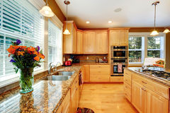 Kitchen maple storage combination with granite tops Royalty Free Stock Image