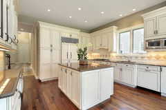 Kitchen with marble island Royalty Free Stock Image