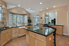 Kitchen with marble top island Royalty Free Stock Photos