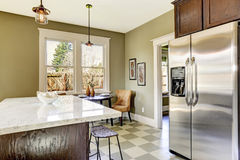 Kitchen with marble top island Royalty Free Stock Photography