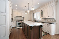 Kitchen with marble and wood island Royalty Free Stock Images