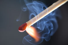 Match Ignition Closeup with Blue-Smoke Curlicues Stock Image