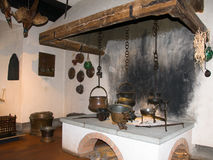 Kitchen of medieval castle. With cooking pots and fireplace Royalty Free Stock Image