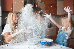 Kitchen mess. Mother with family haveing fun at kitchen with flower stock photos