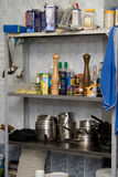 Kitchen metal shelfs with utensils, utensils and p Royalty Free Stock Image