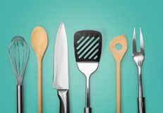 Kitchen metal and wooden utensil on background stock photography