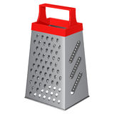 Kitchen metallic tetrahedral grater with a plastic handle on top Stock Images