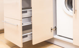 Kitchen Mini Cabinet with Portrable Washing Machine Inside Stock Images