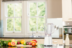 Kitchen with mixer and fruit on counter Royalty Free Stock Photos