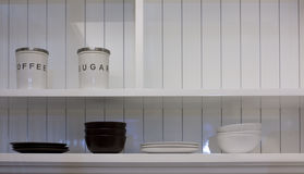 Kitchen. The Modern  White Side Board and bottle, bowl,plate , in the kitchen Stock Image